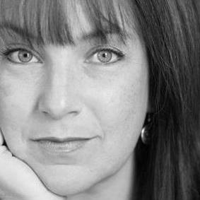 Jeanne Devon (AKMuckraker) Headshot